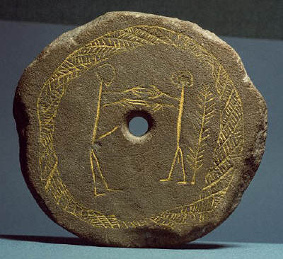 Bronze Age sandstone lid of a cremation urn
