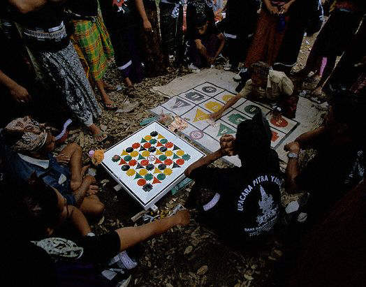 People Playing Game During Cremation. Bongkasa, Indonesia