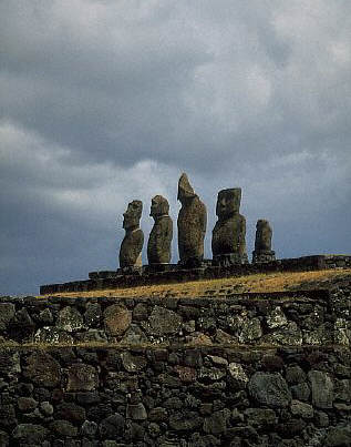 Five stone moai on a hill supported by stone walls at Ahu Tahai, Easter Island