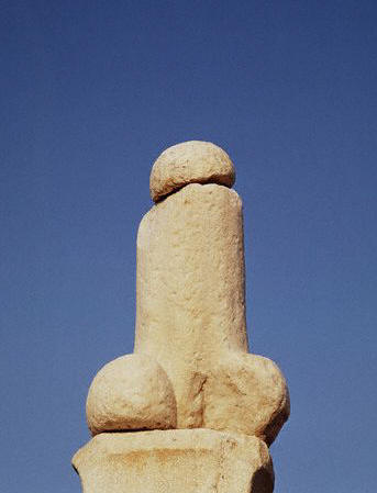 A giant phallus stands outside the Sanctuary of Dionysus on the Delos