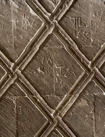 Graffiti on Norman early 12th century stonework, Canterbury Cathedral