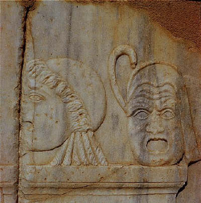 Sculptural reliefs of two masks on the base of the stage of the Roman theater of Sabrata, Libya, 180 A.D.