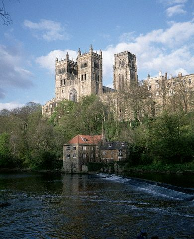 A view of Durham Cathedral from the south west showing the river Wear and the old fulling mill. England