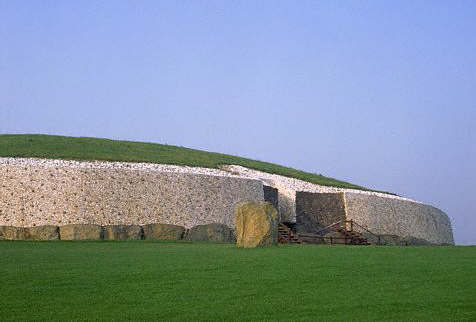 Large flat stones surround the base of the burial mound at Newgrange