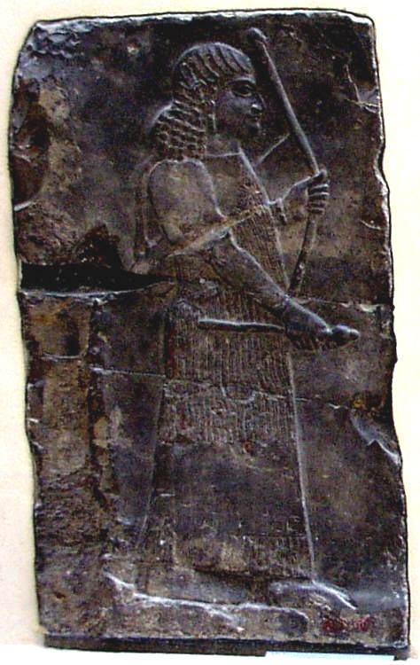 Assyrian Genie holding Poppy Flower, Musee Louvre