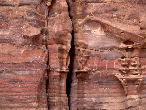 Crevices in a sandstone rockface at Petra