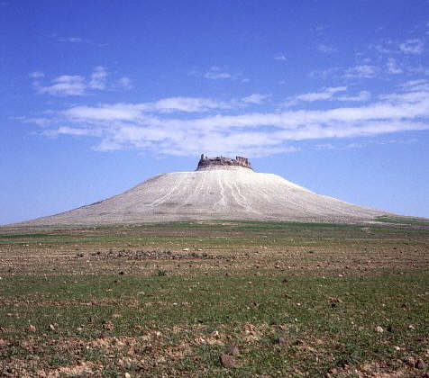 The ruins of a Roman fort, crown an extinct volcano at Shmiamis, in Syria.